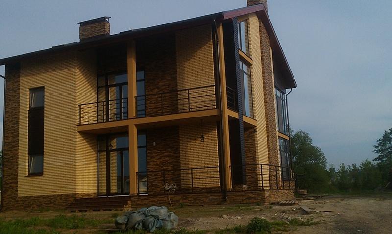 отделка фасада кирпичных домов фото