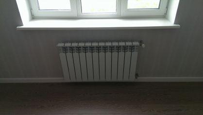 Установленный радиатор Рефар